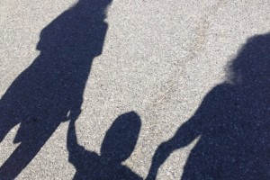 Silhouettes on a sidewalk (left-to-right: my daughter Brittany, her lil cherub Brody Jo (22 months), and me) June 2012